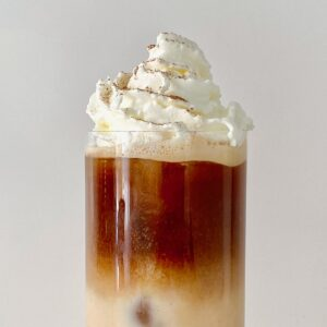 Pumpkin spice latte topped with whipped cream